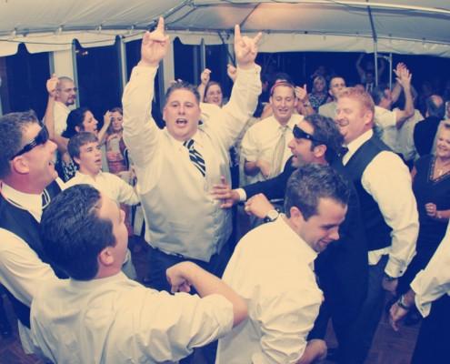 The bridal party dances