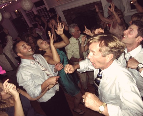 Everyone is dancing at this fun wedding reception